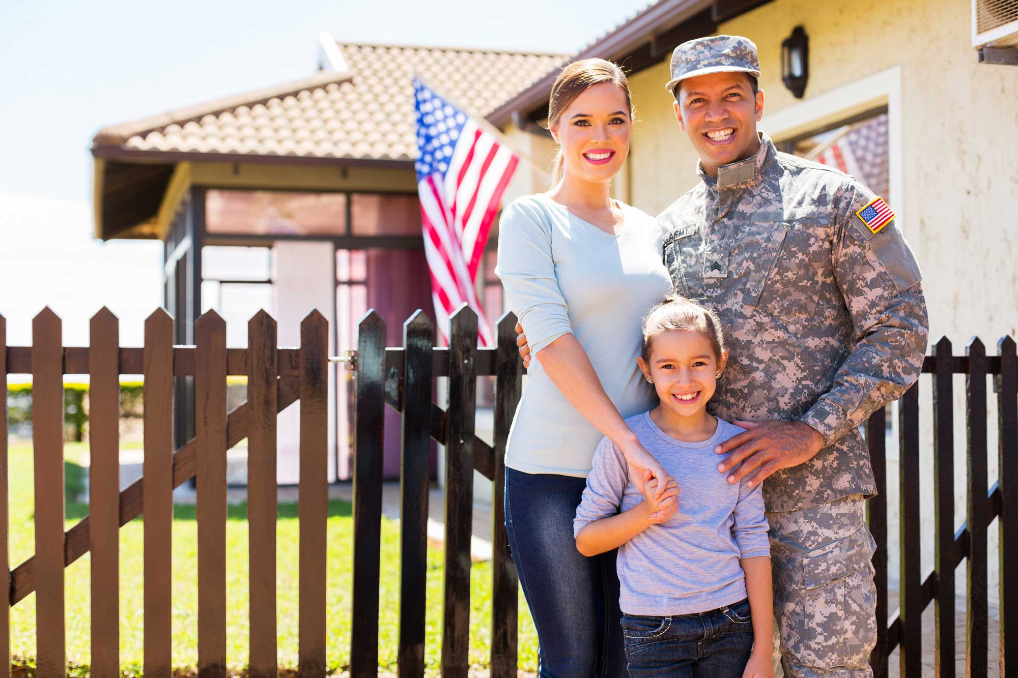 Military Family in front of their new home
